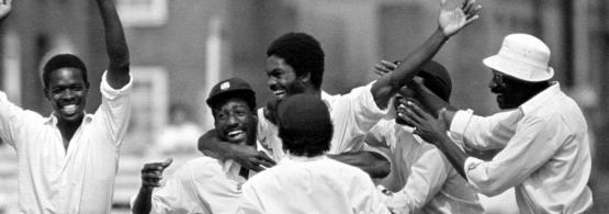 Michael Holding celebrates with West Indies team-mates